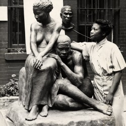 Augusta Savage with one of her sculptures, 1938. (Archives of American Art)