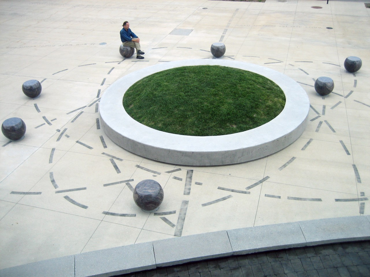 Detail of the Atom Seating Area: The dot of the question mark is also an atom with granite seats as the orbiting electrons.