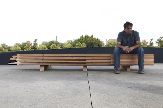 Artist Pete Goché, who teaches architecture and design at Iowa State University and has done research in anthropology, sits on Cultural Carriage installation.
