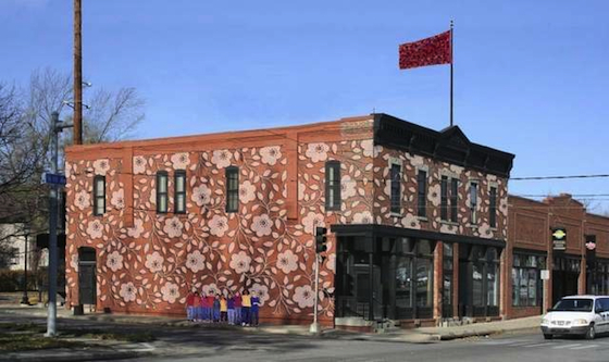 Another proposed design reveals a natural pattern of large-scale (rosy-colored) flowers and vines  which wrap two sides of the Wherry Building. This building is located at the corner of 6th and College Avenues, north of the downtown core in Des Moines, Iowa.