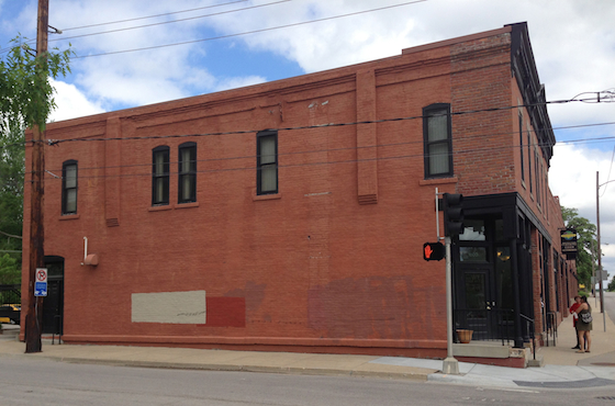Two buildings were identified and both are owned by the Neighborhood Development Corporation (NDC) of Des Moines; eventually the focus became the Wherry Building (pictured above in May 2013) at College and 6th Avenues, north of the downtown core in Des Moines.