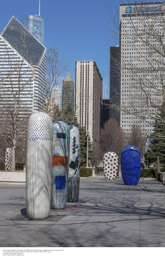 "Kaneko's signature Dangos (meaning ""rounded form"" or ""dumpling"" in Japanese) are feature, too. These ceramic steles, covered in a variety of vibrant shapes and patterns, allow viewers to examine their environment and focus on a sense of scale and place. Standing next to these monolithic structures, one can feel the tension between size, material, location and aesthetics."
