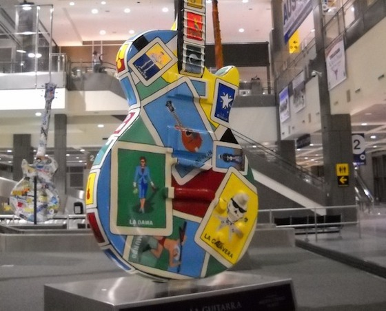 Much of the artwork at Austin-Bergstrom International Airport (AUS) reflects the local and regional landscape, history and culture. That includes the vibrant music scene, which is celebrated in part with a collection of eight ten-foot-tall guitars in the baggage claim area, commissioned by Gibson Guitars and decorated by local artists.