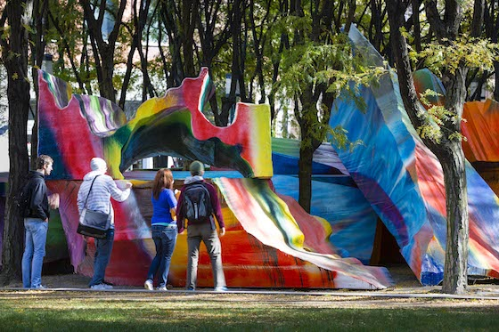 """Just Two Of Us"" is a series of massive multi-coloured sculptures which have taken over the Brooklyn's MetroTech Commons plaza, looking like the architectural remains of a post-punk psychedelic society. It's bright, bold and inescapably interactive!"