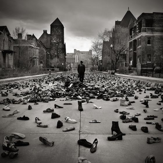 Tyree Guyton created the public installation Street Folk, formed from 10,000 paired and unpaired discarded and donated shoes. This piece highlighted the plight of the homeless in Detroit and once again sees him using his abilities to engage critically into the social and environmental fabric of the city.