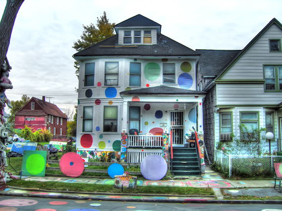 "Considered the most famous house in the Heidelberg Project, this house ( the ""New White house"" - formerly referred to as the ""Dotty Wotty "" House ) was in the artist's family since 1947. This is where Tyree Guyton first was inspired to paint, the dots represent two things: His Grandfathers love of jellybeans, and the unity of all people."
