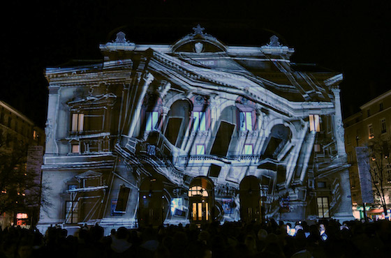Projection Mapping is a recent development in projection technology, in which an image can be specifically 'placed' onto the features and contours of an object.  Paired with careful pre-production, it is possible to achieve stunning results.