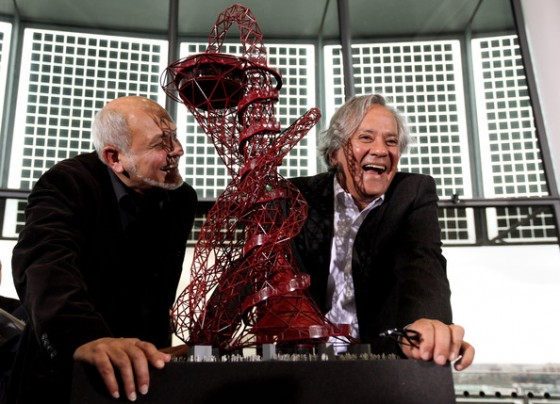 "Cecil Balmond and artist Anish Kapoor pose with Kapoor's winning design for  the 2012 Olympic Park  in London, England. The steel structure entitled ""The ArcelorMittal Orbit."""