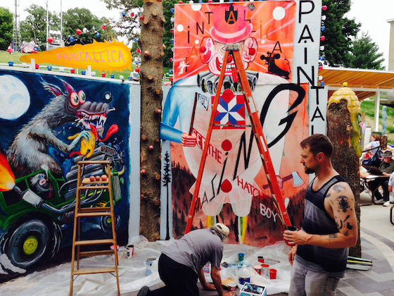 Members of Paintallica creating an installation at the Iowa State Fair. This public art project will be on view through August 17, 2014.