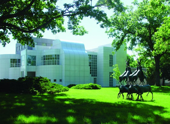 """View of 2nd building addition to the Des Moines Art Center with sculpture """"Animal Pyramid"""" by Bruce Nauman."""