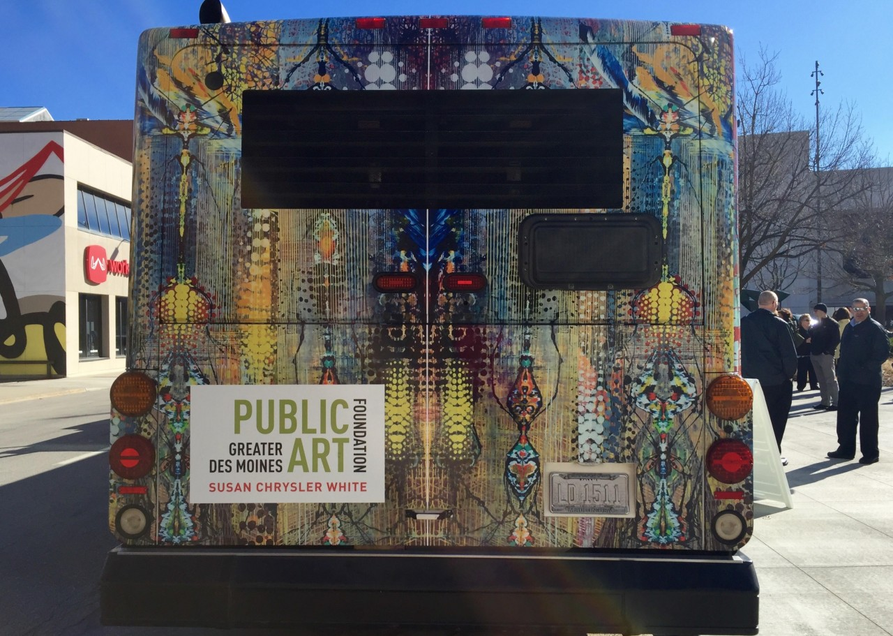 Detail: View of Susan Chrysler White design on back of a large transit bus.
