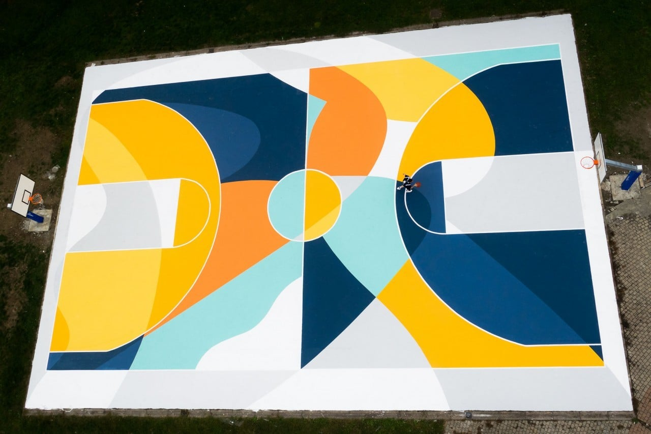 Public Art: basketball court turned into a labyrinth of lines and colors